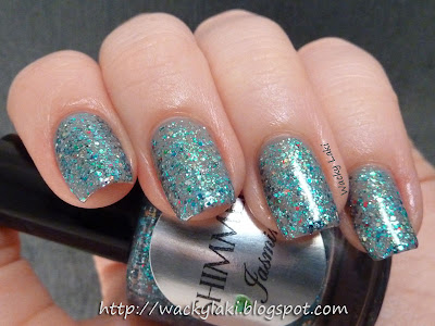 Teal glitter with red orange green and blue specks peppered