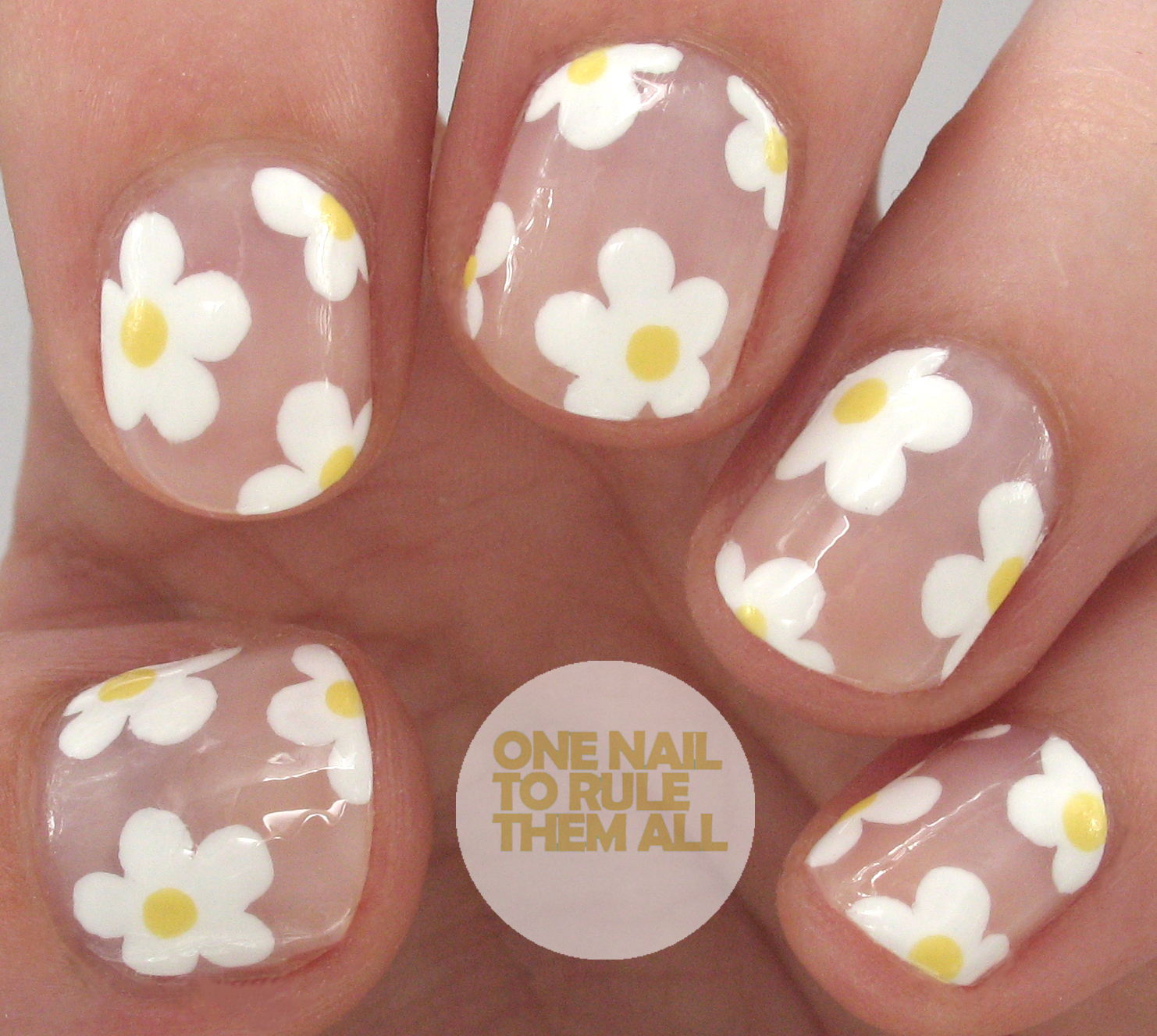 One nail to rule them all negative space daisy nail art for these i used one coat of sally hansen shell we dance as a base and then i used a nail art brush and barry m cotton for the flowers prinsesfo Gallery