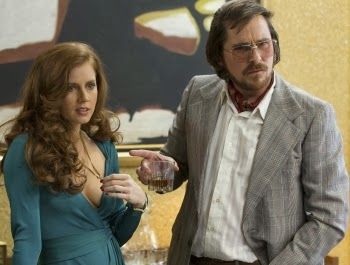 Amy Adams and Christian Bale star in AMERICAN HUSTLE, nominated for 10 Academy Awards