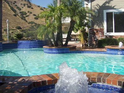 Pool tile cleaning pro 877 835 8763 orange county los angeles riverside palm springs brea la for Swimming pool demolition los angeles
