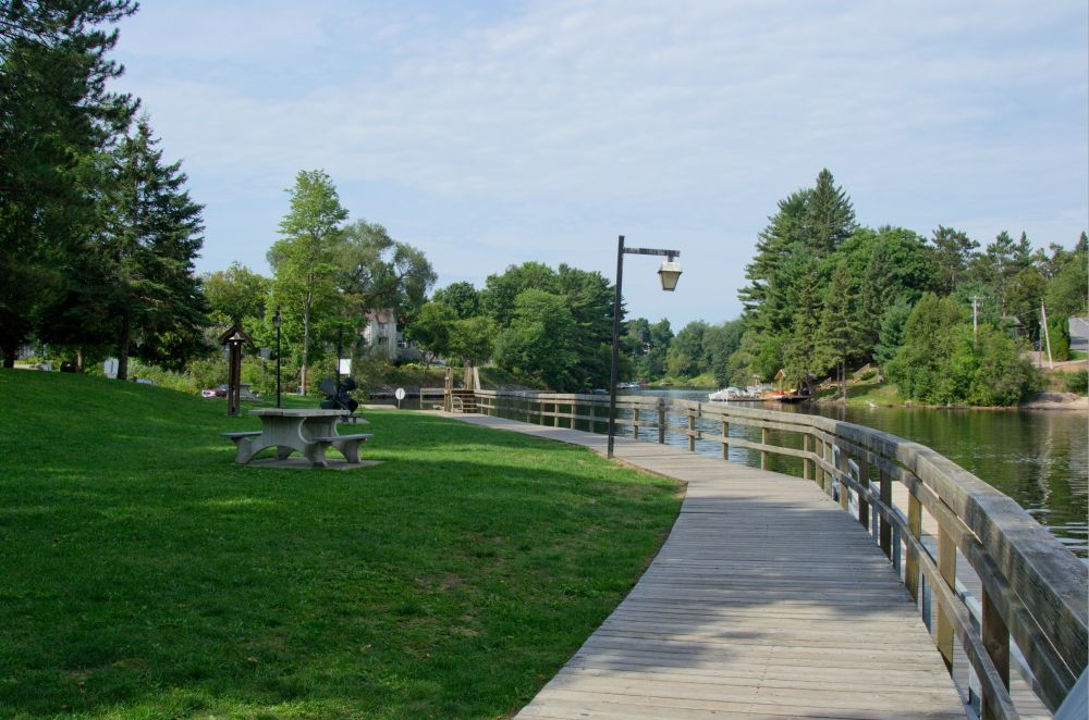 The waterfront park in Bracebridge with it's boardwalk and grassy hills, and vintage style lighting.