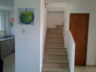 imag of stairs leading to the tv room balcony and 2 bedrooms