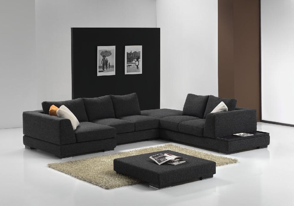 Centro divani piacevole divano angolare in tessuto scuro for Divano angolare in tessuto