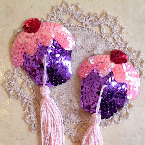 https://www.etsy.com/uk/listing/200675981/cupcake-nipple-tassels?ref=shop_home_active_14