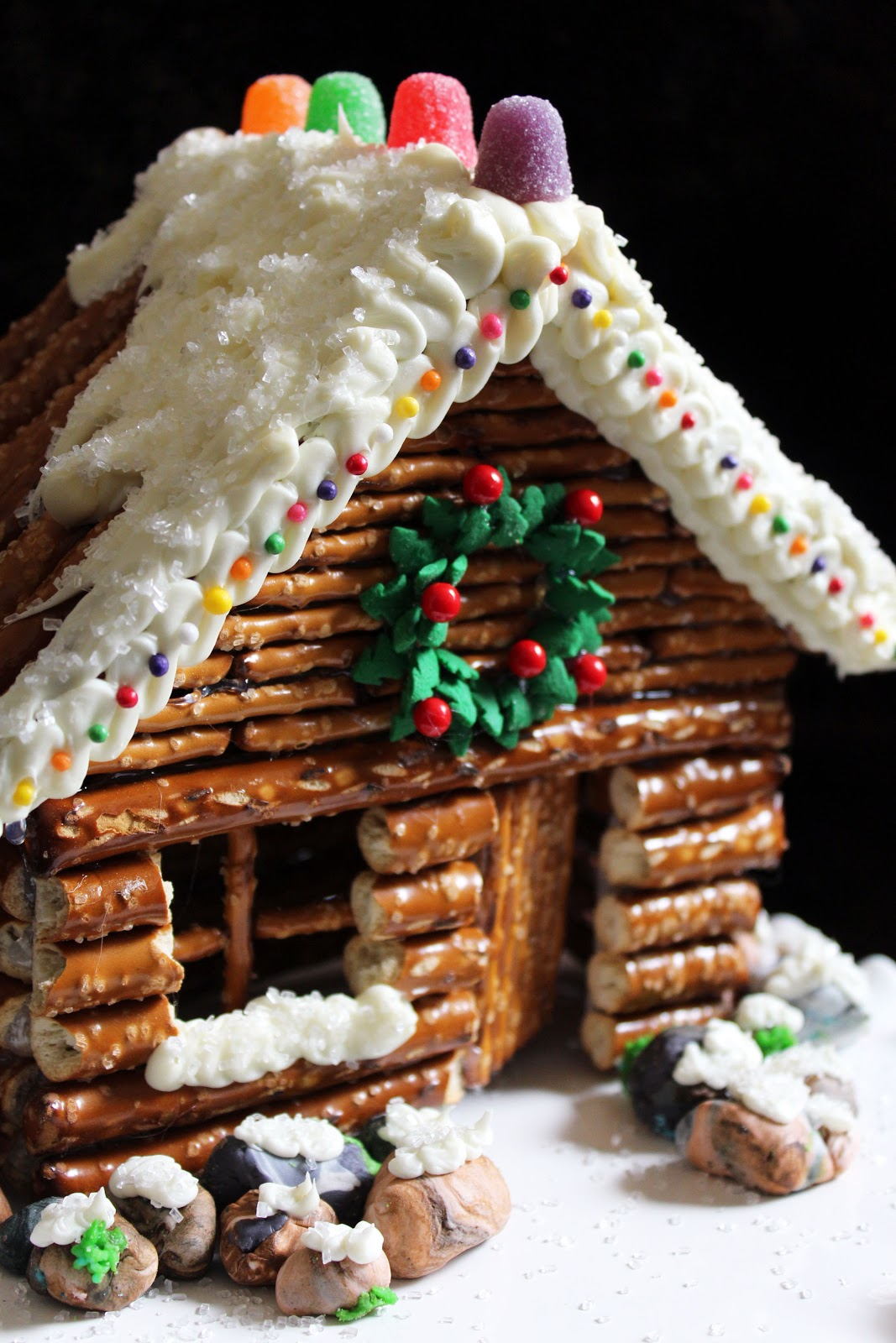 design for roof gingerbread house html with Decorated Pretzel Cabins on Stone Cabin Gingerbread Cottage further Morgan Freeman House in addition Queen Anne Style Architecture furthermore Victorian Running Exterior Trim also Blue Front Door For A Warm And Friendly House.
