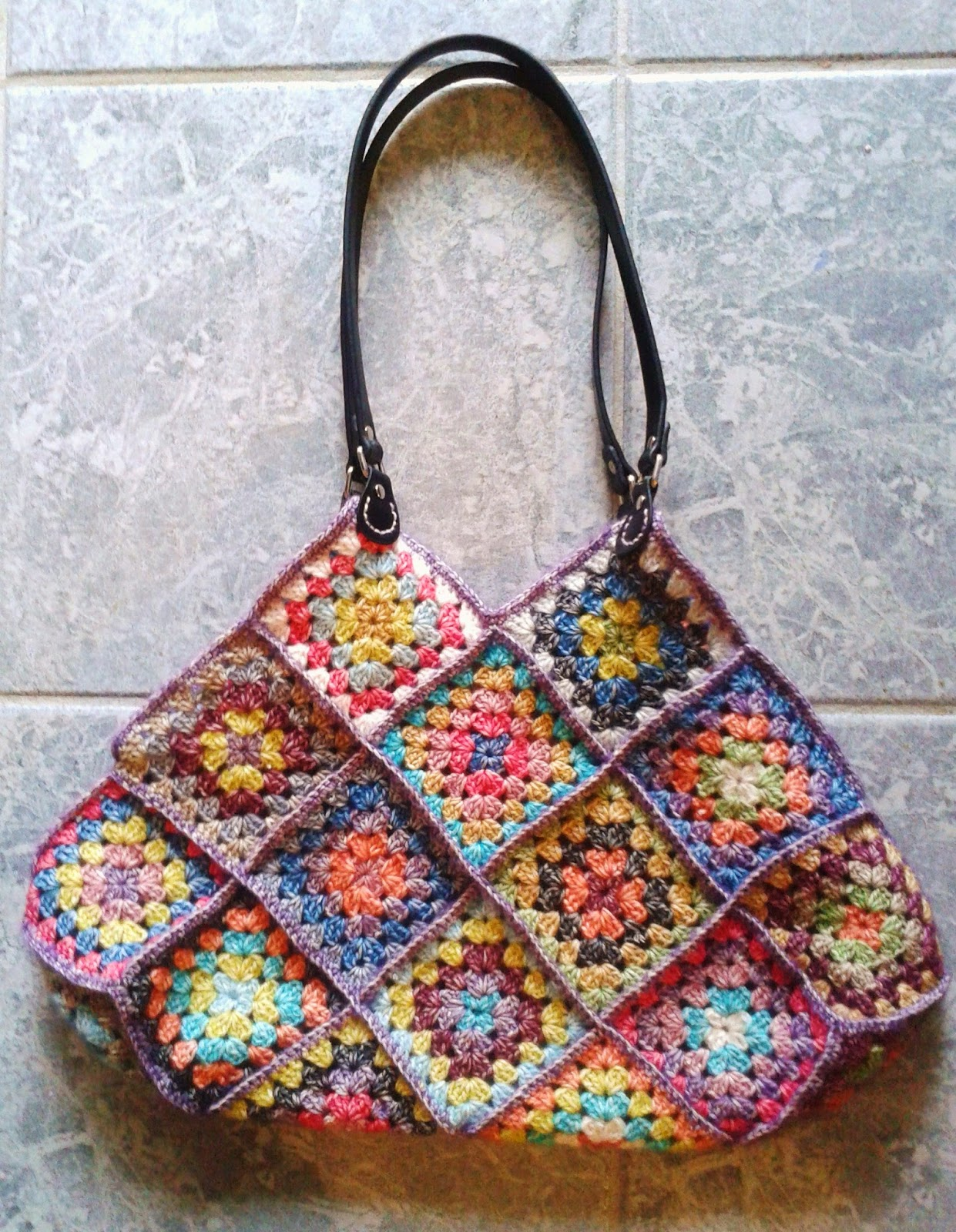 new bag and it is finished a colourful granny square crochet bag