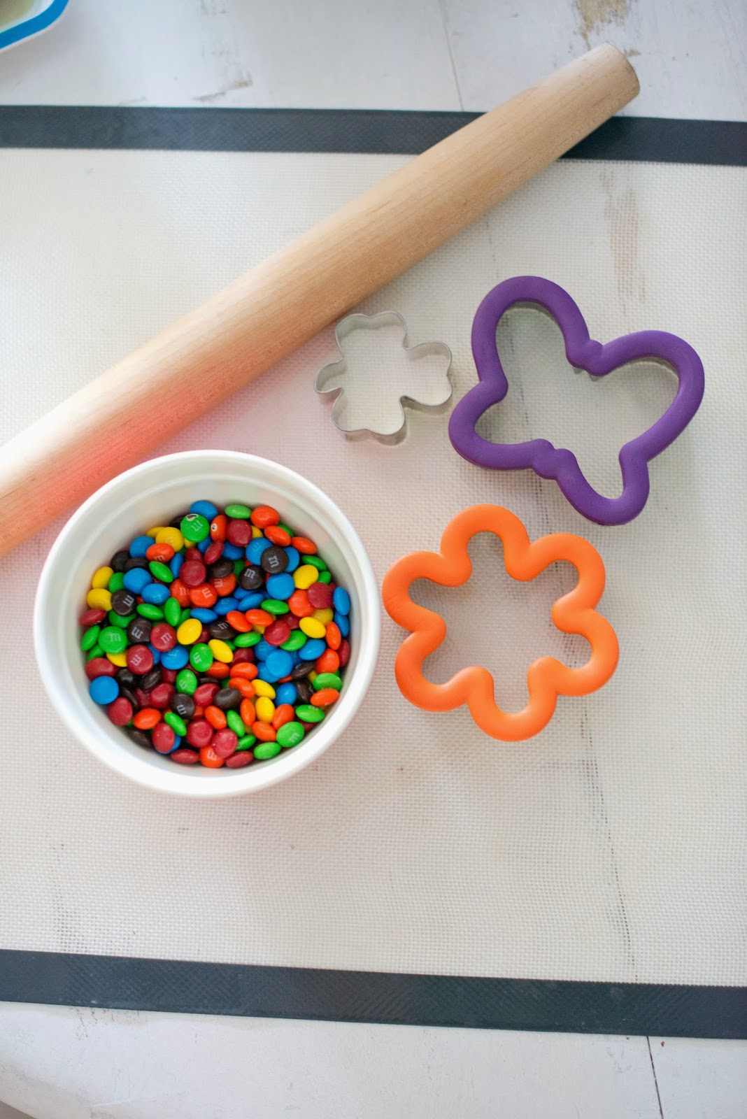 Fun kids party activity--roll out and cut sugar cookies and press in m&ms