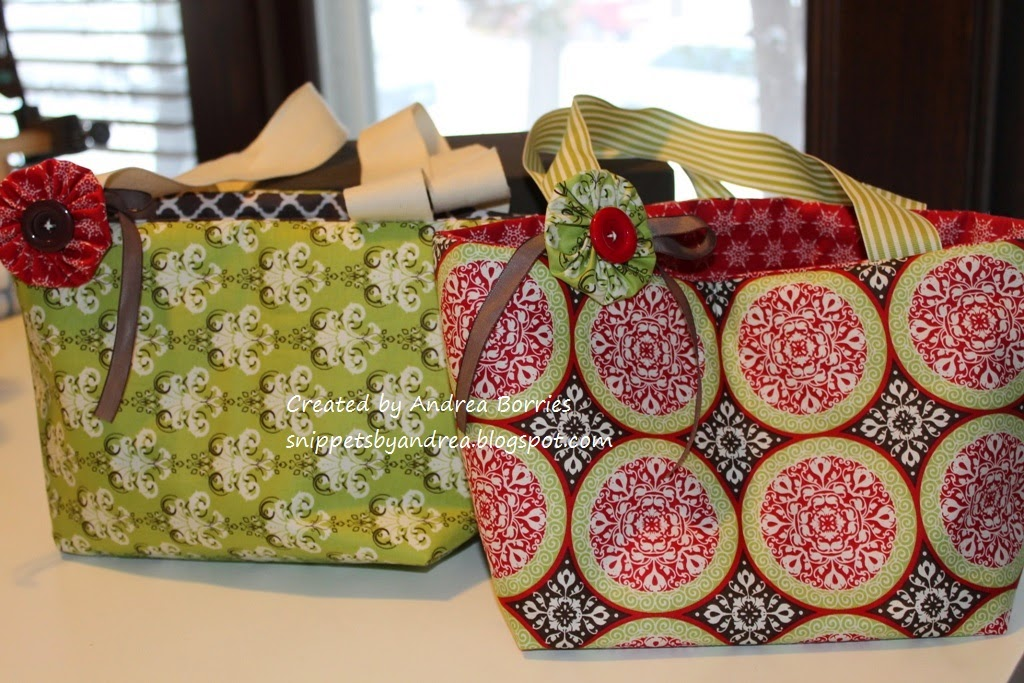 Reversible small bags made from Christmas-print fabrics and ribbon handles.