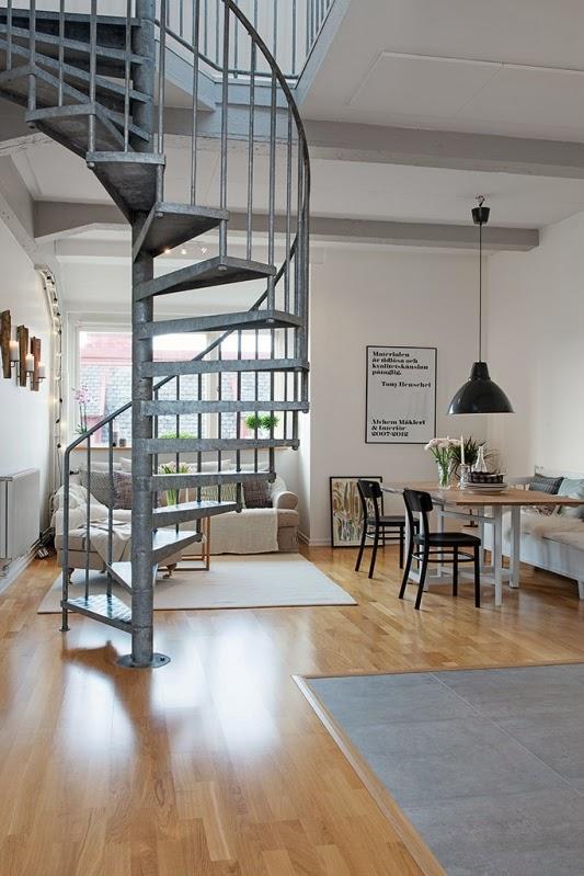 apartamento dúplex de estilo nórdico con escalera de caracol