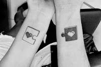 Tatuagem quebra cabeça casal