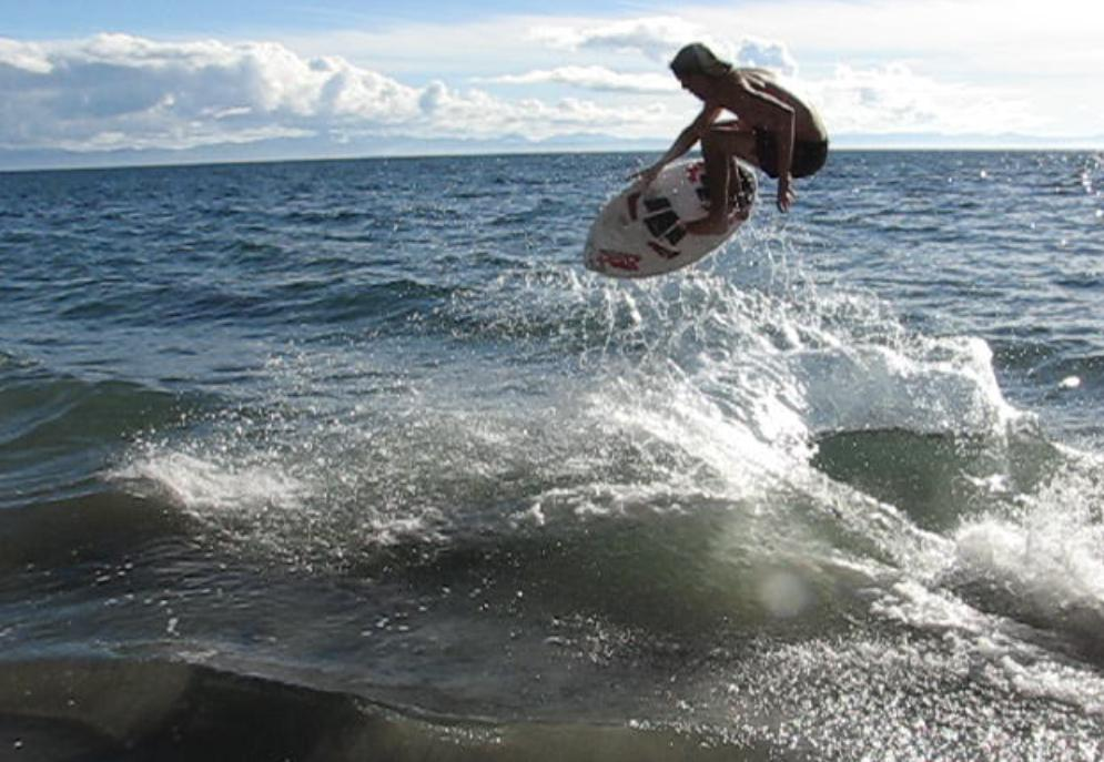 comparative essay of surfing and skimboarding Atlantic surf, a danforth anchor wedged offshore, bungee cord and waterski handles ftw.