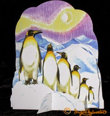 3D pop up Christmas cards by UK artist Ingrid Sylvestre Greeting Cards designer Three Dimensional Cards for Christmas and other occasions Fully 3 dimensional paper engineering cards pop out when opened Winter Wildlife 3D pop up Christmas card Penguins Ingrid Sylvestre North East artists UK