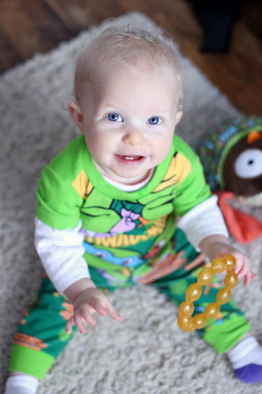 baby girl in teenage mutant ninja turtle pajamas