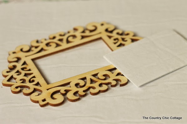 DIY Gold Frame Ornament -- an easy ornament that will look elegant on any tree this holiday season.  Click the picture to learn how to make your own.