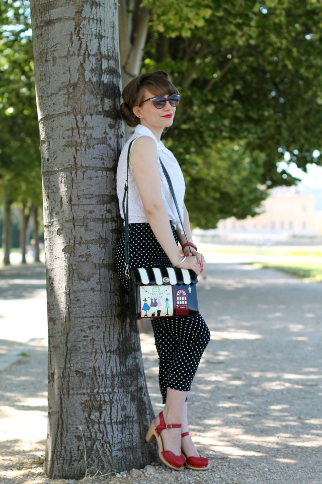 Polka dot capris, clogs and a quirky bag