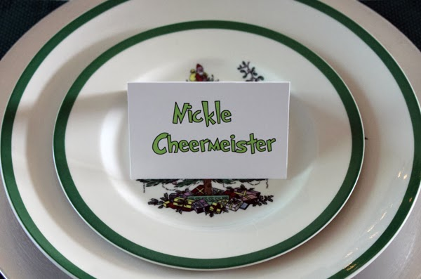 Place cards and table settings for a Grinch holiday party