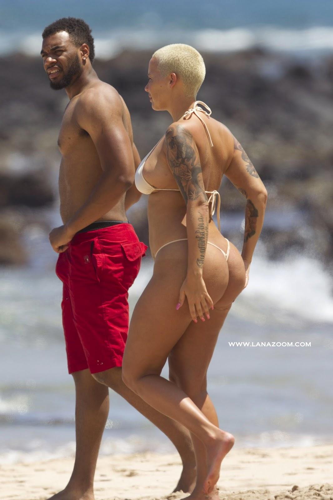 صور امبر روز بالبكيني الساخن جدا و تظهر حلمة صدرها في شاطىء ماوي