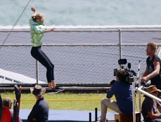 At the seashore in Cape Town, South Africa, the stunning brunette, Candice Swanepoel, 27, has been very busy to participate in the development of new advert on Saturday, December 19, 2015. The Supermodel flying and running in a green light jacket and black leggings.