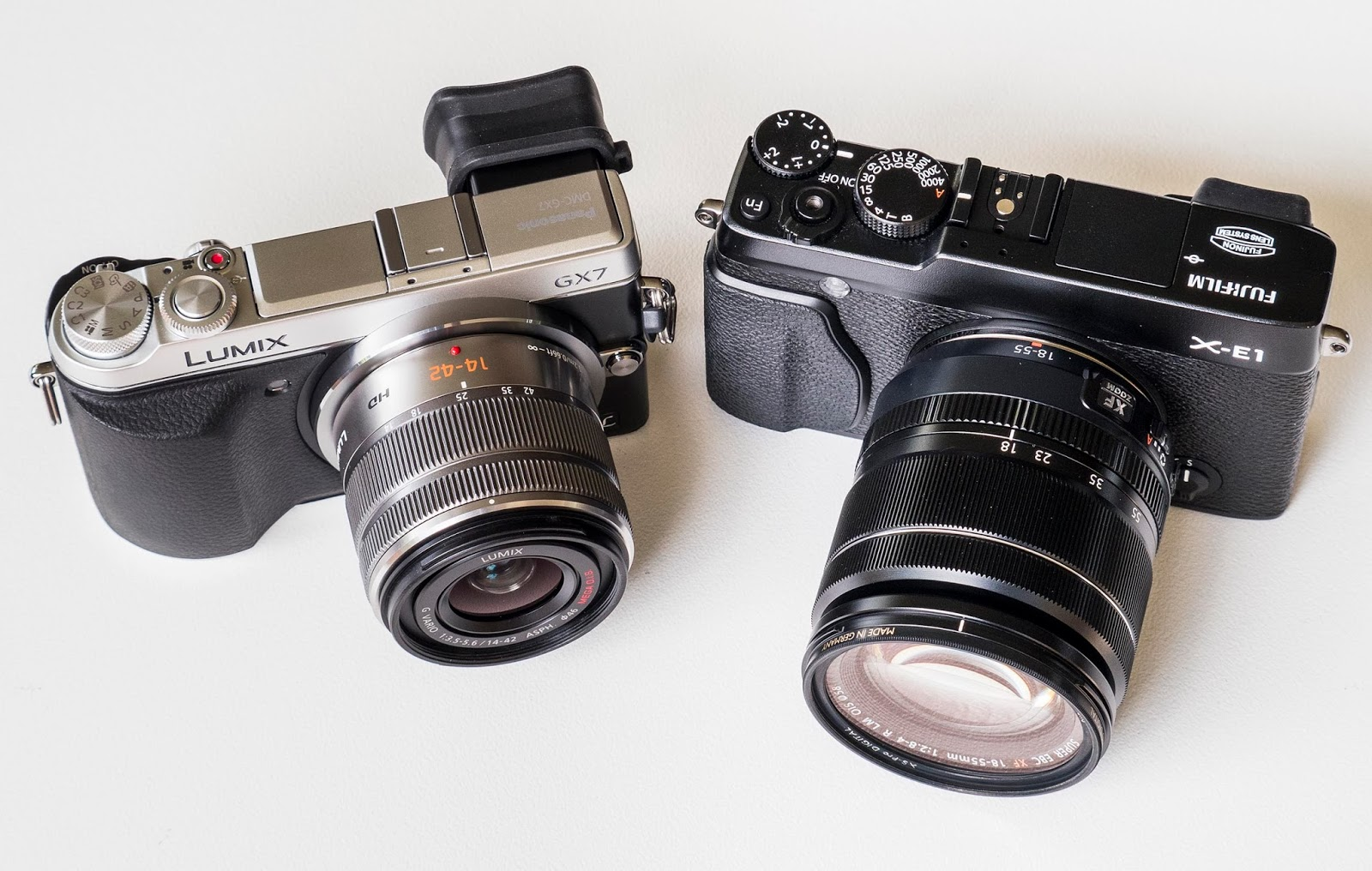 GX7 with 14-42mm Mk2 lens. On the right Fuji X-E1 with 18-55mm lens