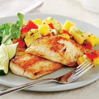 Picture of Sautéed Fish and Tropical Salsa on a white plate and a fork.