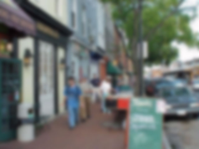 A street/sidewalk scene that has been altered to reflect the way it might be seen by someone with a visual impairment. Credit: The Blindo Diaries