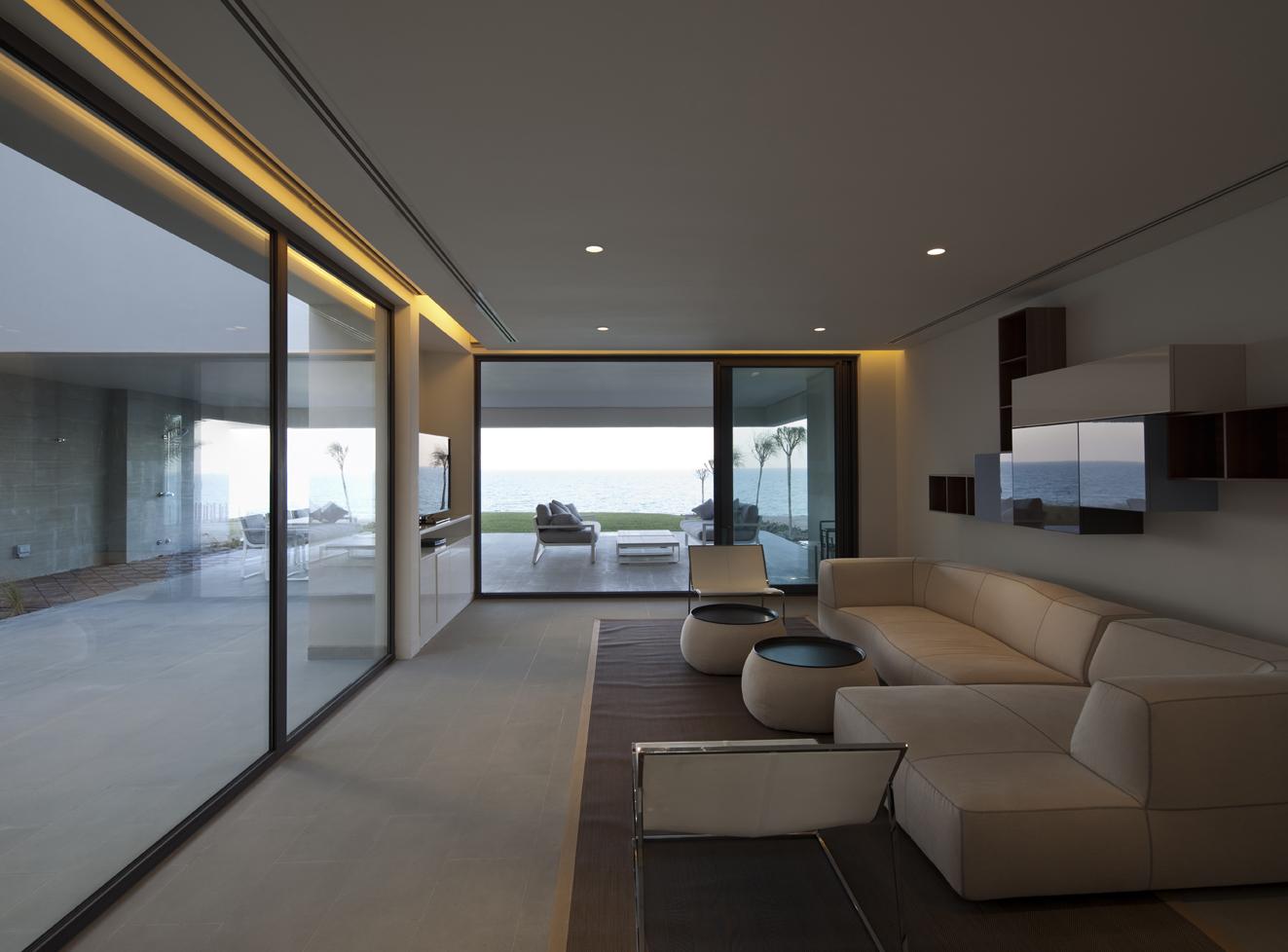 Baños Con Vista Al Mar:Casa S Cube por AGI Architects