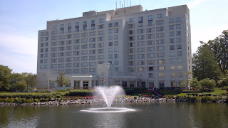 hotel with water fountain on a lake