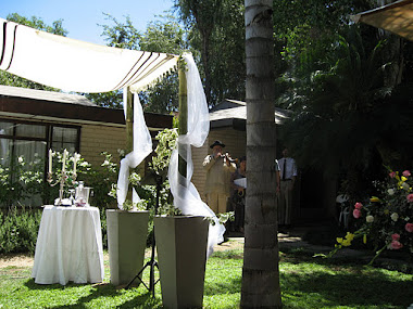 A Chuppah with a Tallit covering (standing on its own-not held by 4 people like in other cases)