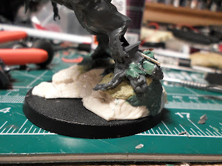 the base of the HelBrute showing the built up rock face with green stuff.