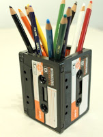 Pen holder made from cassette cartridges.