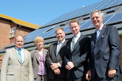 Greg Barker (second from right) in May this year visiting Telscombe civic centre, which installed 54 photovoltaic solar roof panels under the FITs scheme.