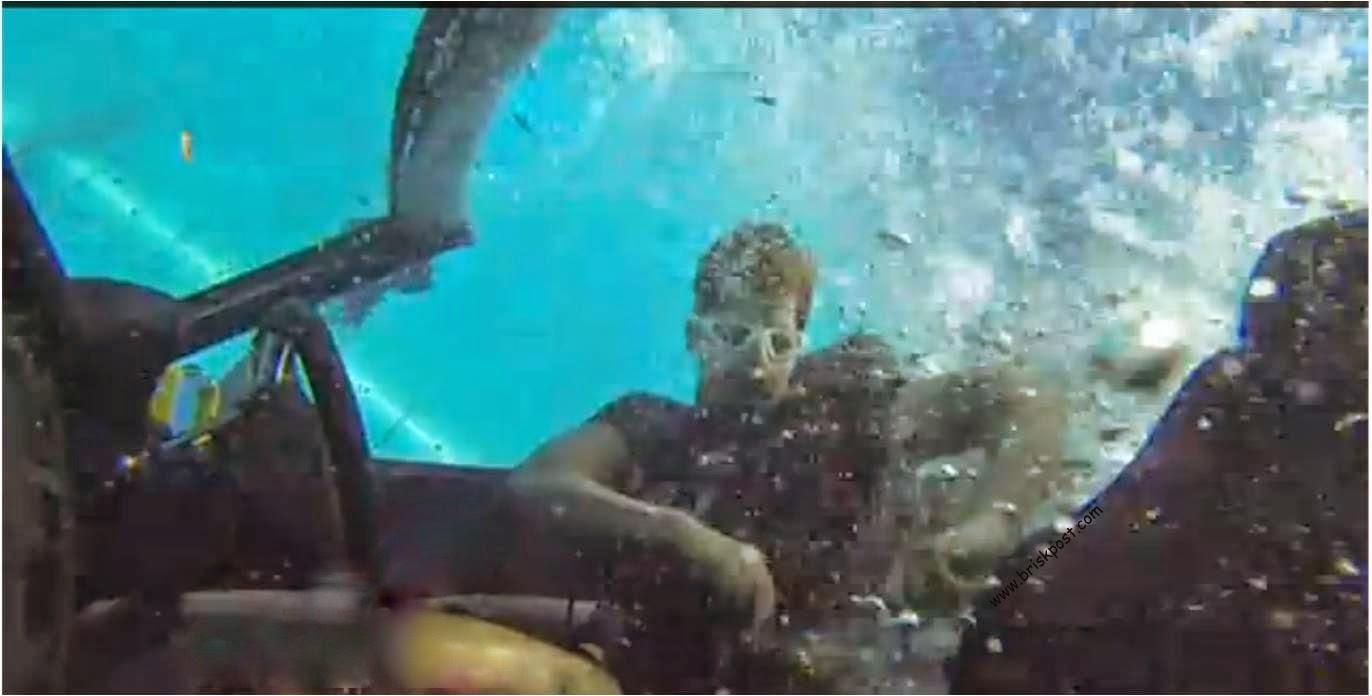 Khatron Ke Khiladi Karanveer unscrewing a box in underwater car stunt