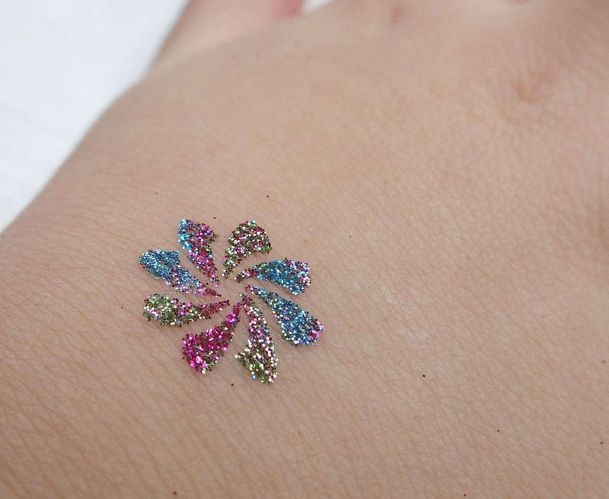 Have a glittery christmas with glitza glitter tattoos body for Where to get glitter tattoos