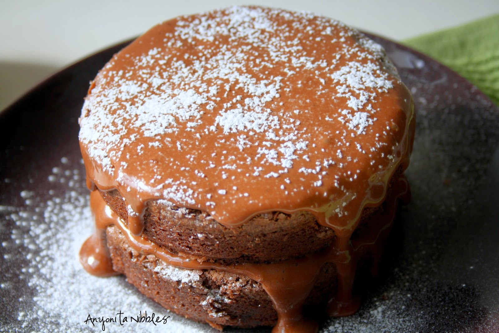 Dust these decadent Nutella brownies with a bit of icing sugar. from Anyonita Nibbles