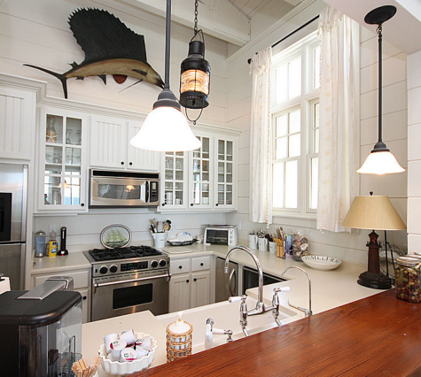 Steering towards nautical nostalgia a home inspired by shipwheels and the movie summer of 42 - Nautical kitchen ...