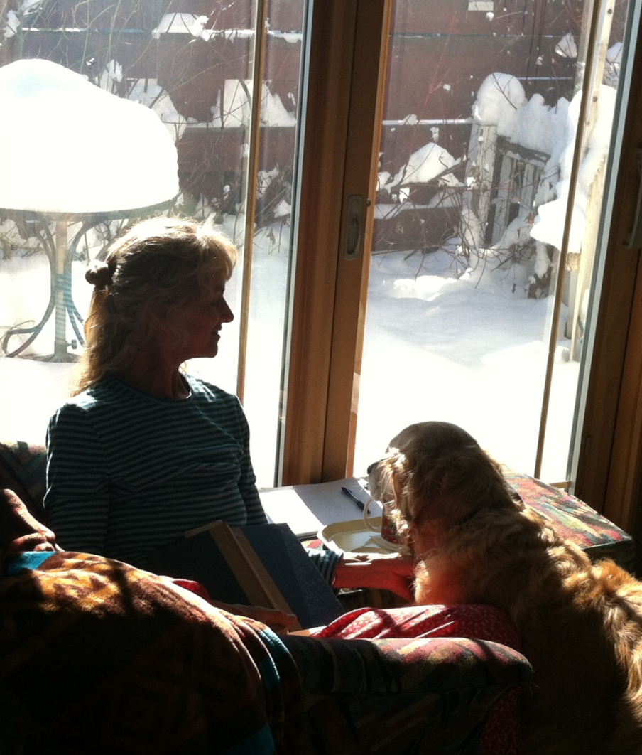 Favorite place to write is our sunroom. Poppy is my good helper.