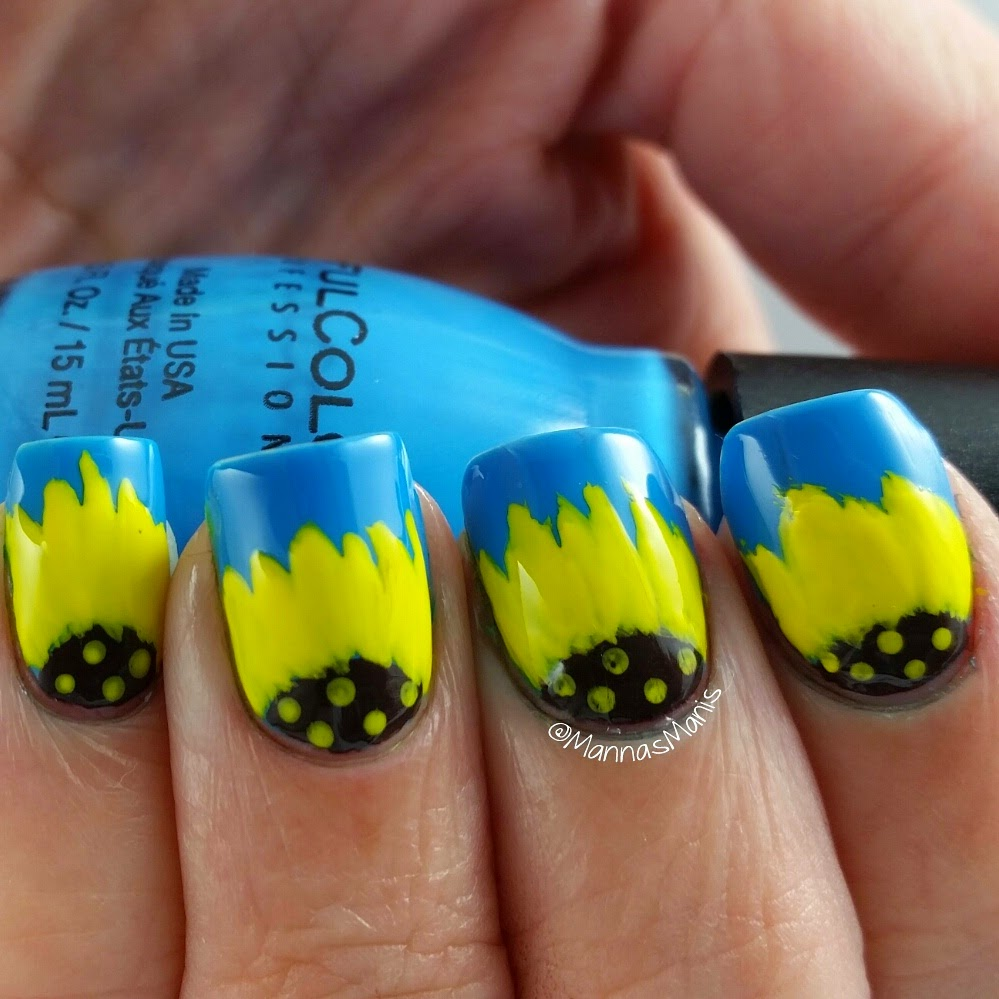 freehand sunflower nail art