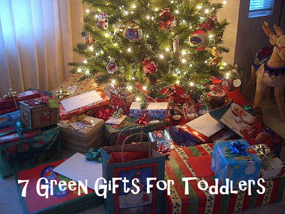 7 Green Gifts for Toddlers Christmas Tree surrounded by wrapped presents