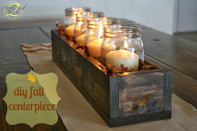 http://addicted2diy.com/2013/10/31/diy-fall-centerpiece/