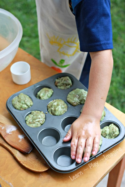 Making pretend muffins with apple pie playdough