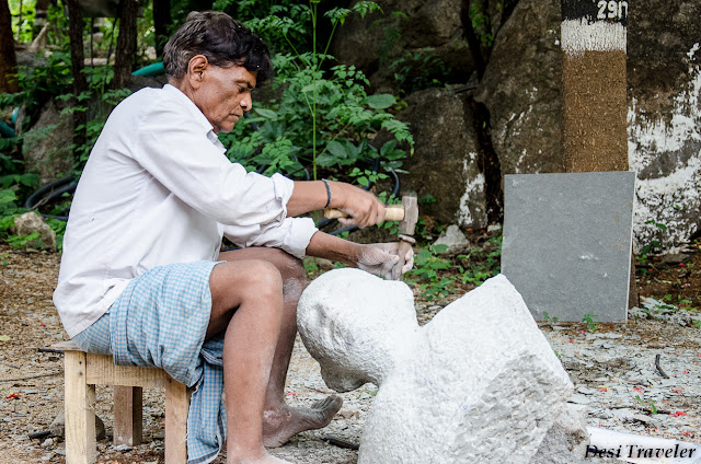 man making stone idols at shilparamam