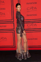 Adriana Lima shows off her figure in a glamorous dress