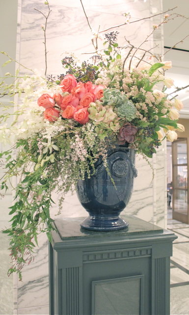 sweet pea floral design Detroit institute of art cobalt stone urn vase filled with hawaiian orchids, coral roses, privet berries parrot tulips rice flower, quince branches jasmine vine wedding flowers michigan wedding florist extra large floral design escort card table ceremony decor succulents blush pinks