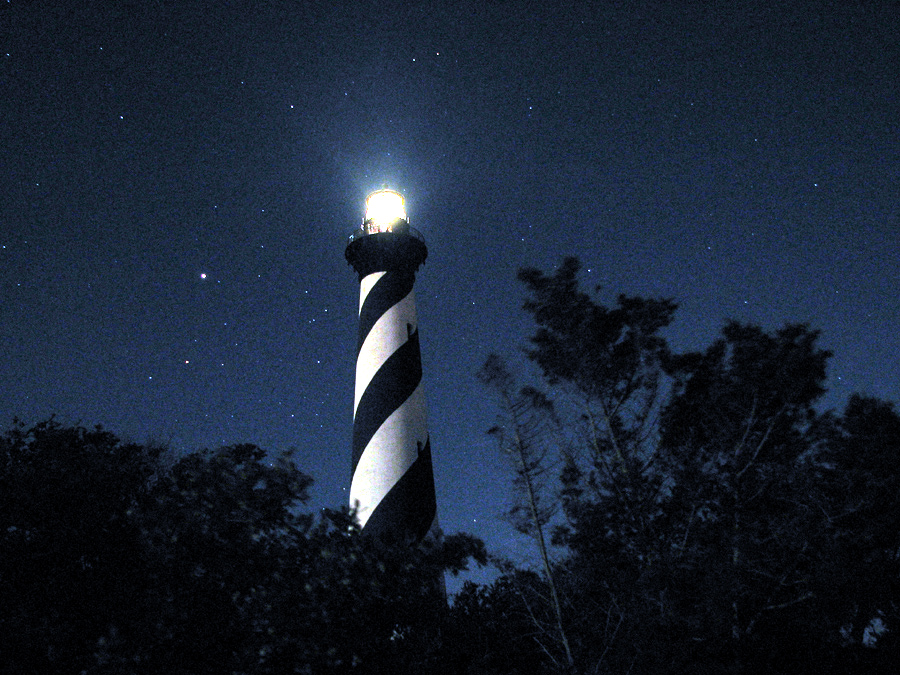 lighthouse at night Honeymoon Destinations for Lovers of Light