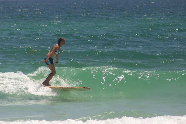 Cinco De Mayo 2012 Cathy Harding longboard surfing on Pensacola Beach, FL at 18th Ave.