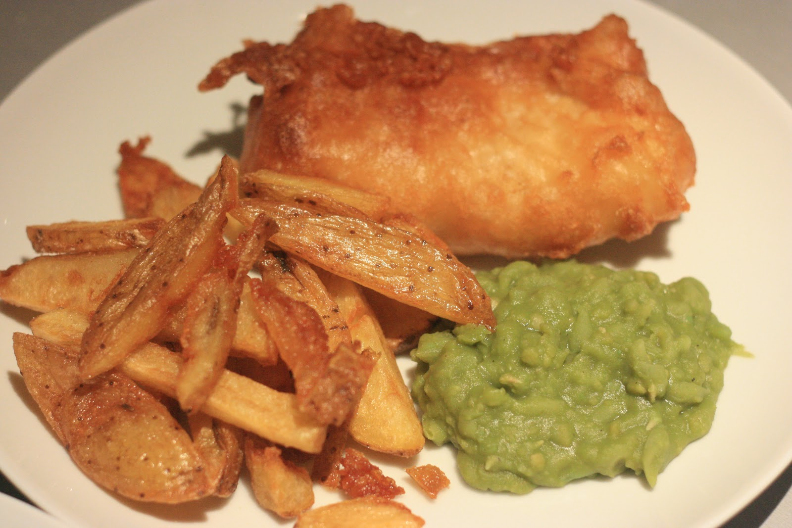 Fish and chips was the first ever meal i cooked for anna it s hard to imagine a candle lit dinner of battered haddock it s greasy messy