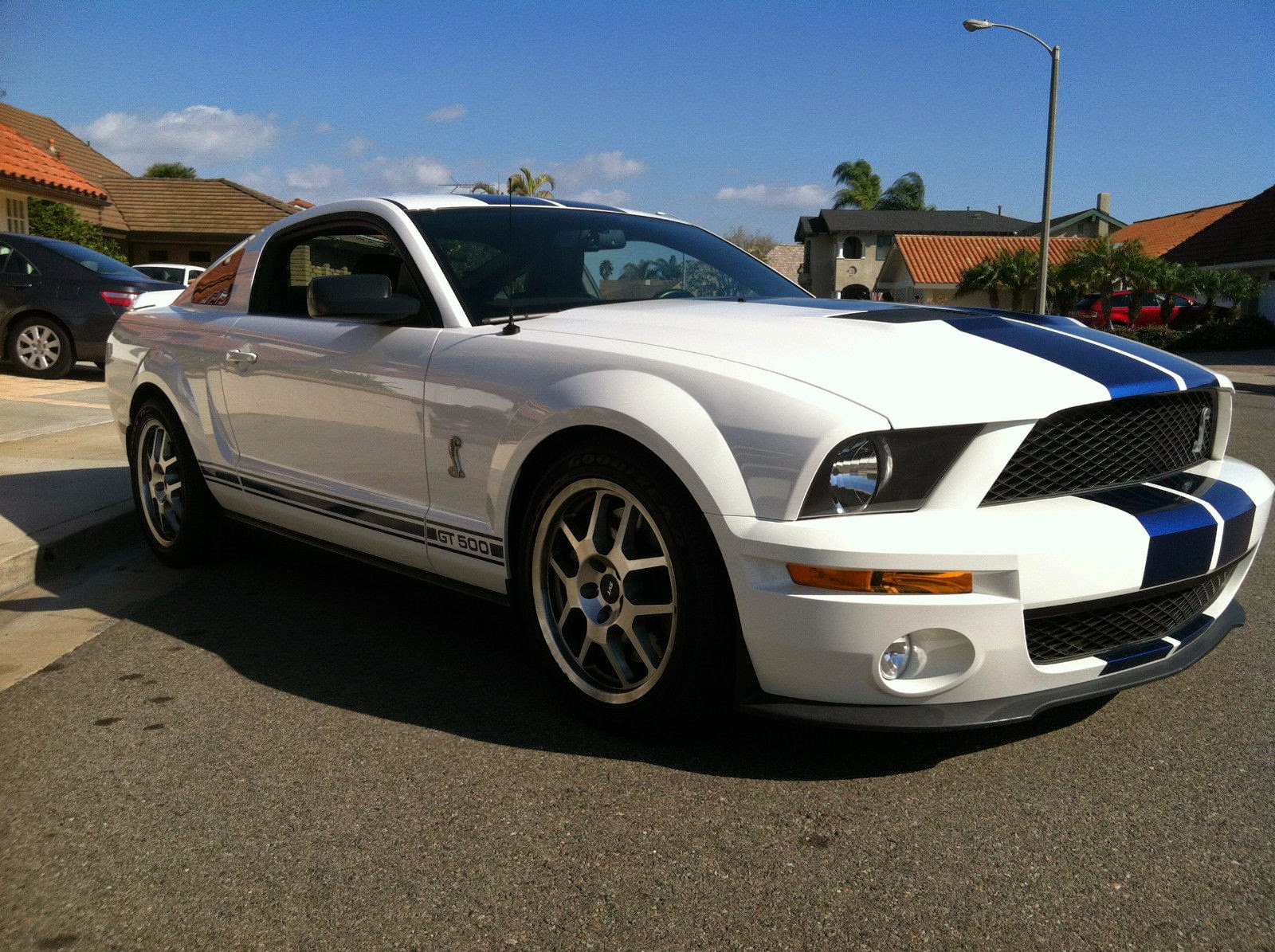 Immaculate white blue stripe 2007 ford mustang shelby gt500 5 4l coupe mildly modified for enhanced handling performance and convenience with the