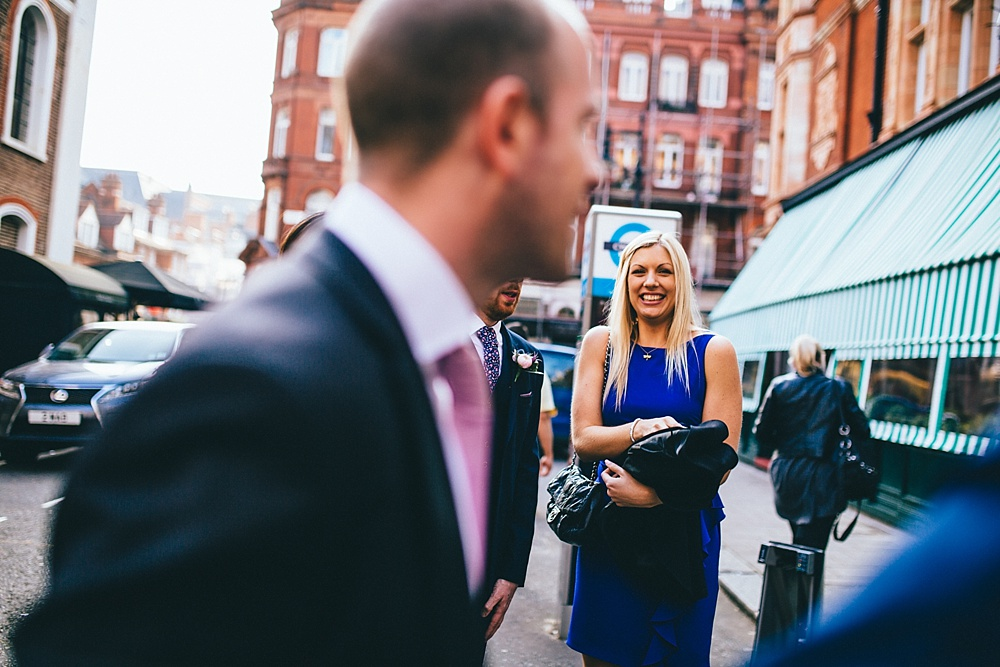 relaxed guest candids natural wedding photography in central london outside mayfair library