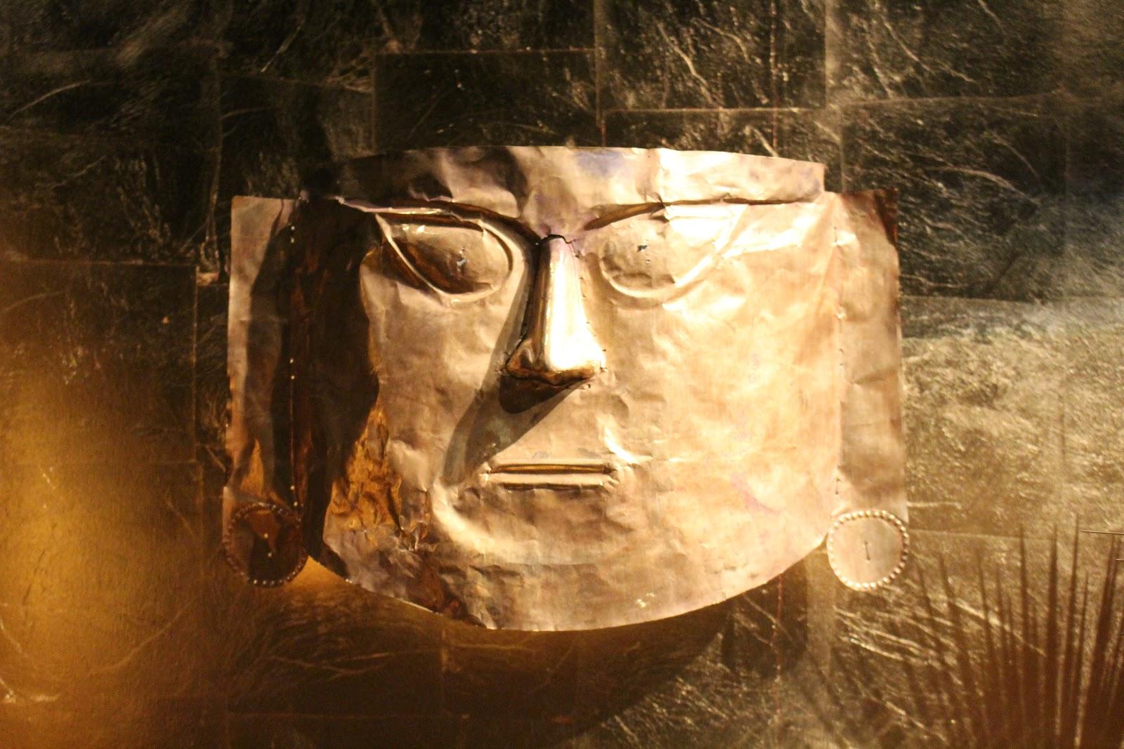 Dries Van Noten Inspirations MoMu Gold Inca mask
