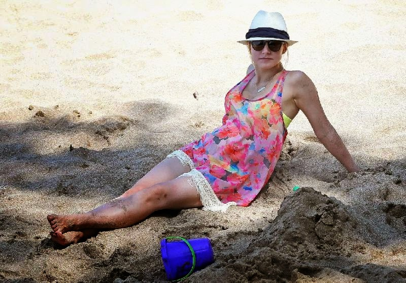 Kristen Bell gets her body back in a Yellow Bikini as she's going vacation in Hawaii